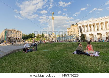 Kiev Ukraine - June 19 2016: Citizens have a rest on the lawn at the Independence Square