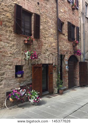 Bicycle and flowers in the walled medieval city of Castiglione del Lago, Fortress of the Lion, Umbria, central Italy