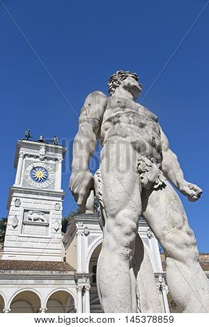 Udine statue of Hercules with clock tower on the background