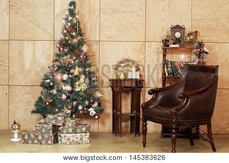 Interior of room with firtree decorated to christmas holidays.