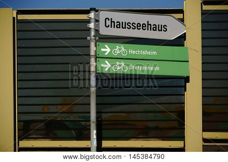 Road signs for bicycle paths and signs are faced with a soundproof wall.