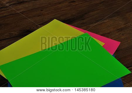 Colorful paper fanned out on a table
