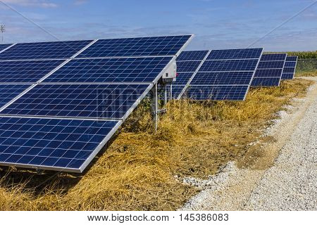 Solar Panel Farm. Corn Fields are Being Converted into Green Energy Areas Using Photovoltaic Cells VIII