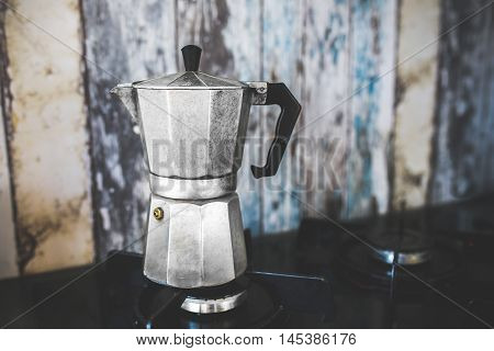 Coffee Pot on Wood Background GuestHouse Morning