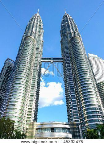 KUALA LUMPUR MALAYSIA - FEBRUARY 29: Petronas Twin Towers on February 29 2016 in Kuala Lumpur Malaysia. Petronas Twin Towers is the tallest skyscraper in Malaysia.
