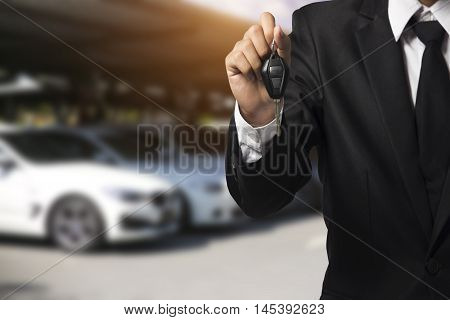 Businessman Showing A Car Key - Car Sale & Rental Business Concept