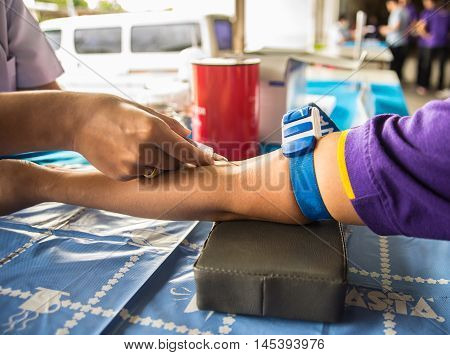 blood test Taking blood from a arm