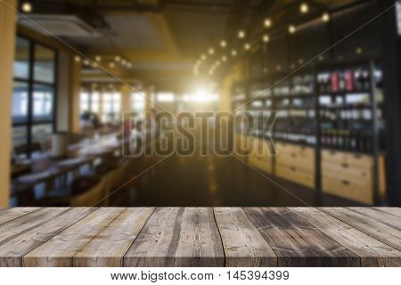 Image Of Wooden Table In Front Of Abstract Blurred Background Of Resturant Lights Can Be Used For Mo