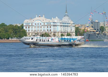 SAINT PETERSBURG, RUSSIA - JULY 28, 2016: The hydrofoil against the building of the Nakhimov naval school sunny day in July
