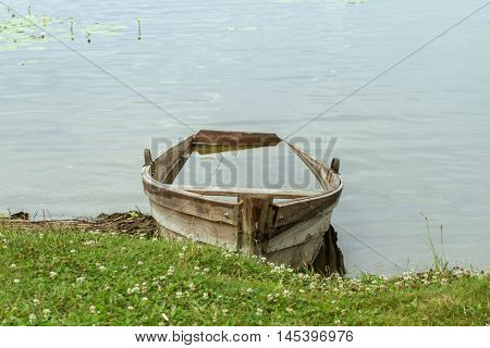 Old Boat Under Water In Lake
