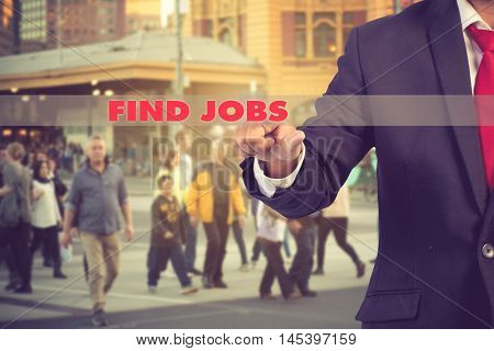 Job Search Concept - Businessman Hand Pressing An Imaginary Button Over Peple Background.vintage Col