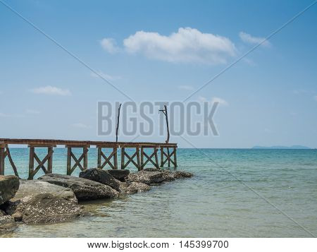 Old Wooden Bridge To The Blue Sea