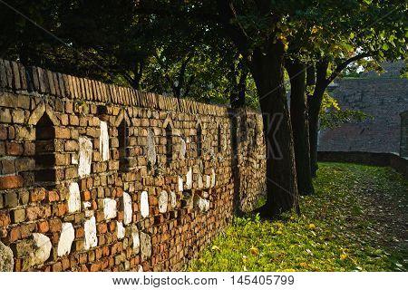 Alley along an old fortress wall - detail from Kalemegdan park in Belgrade, Serbia