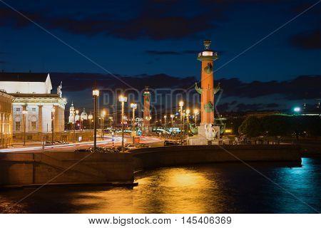 SAINT PETERSBURG, RUSSIA - AUGUST 10, 2016: Arrow of Vasilevsky island in the night light summer night. Historical landmark of the city St. Petersburg