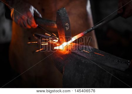 Blacksmith Manually Forging The Molten Metal