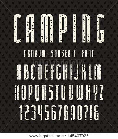 Narrow sanserif font with speckled texture. Bold face. White print on black background