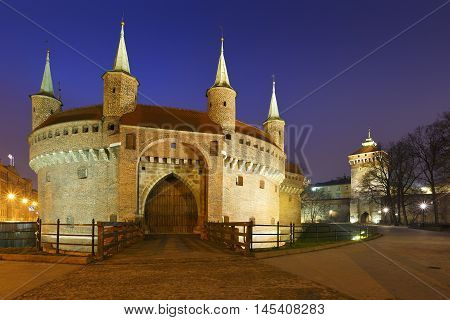 Barbican and city wall in the old town of Krakow, Poland.