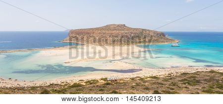 Breathtaking panorama of Balos beach and lagoon and Gramvousa island on Crete, Greece. Cap tigani in the center.