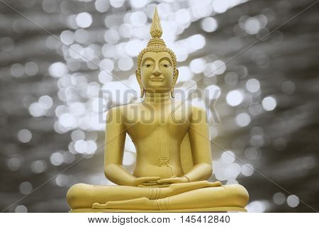 Gold Image Of Buddha On Blurred Light Bokeh Background,filtered Image