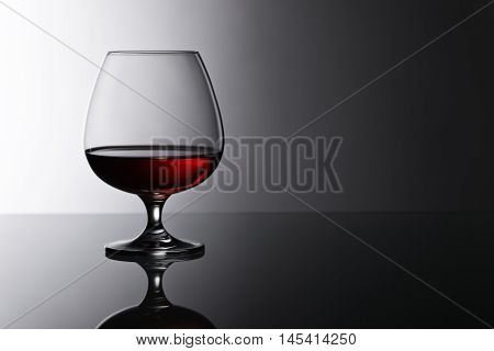 Snifter Of Brandy On Glass Table