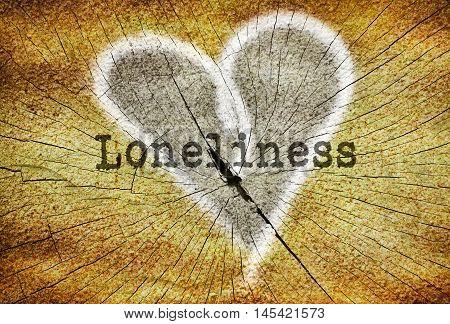 Word Loneliness written over drawn broken heart