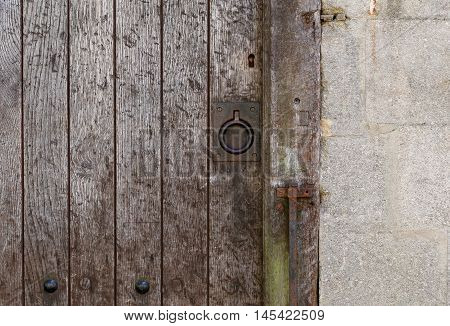 Old Rusty Metal Ring Handle On A Aged Timber Door