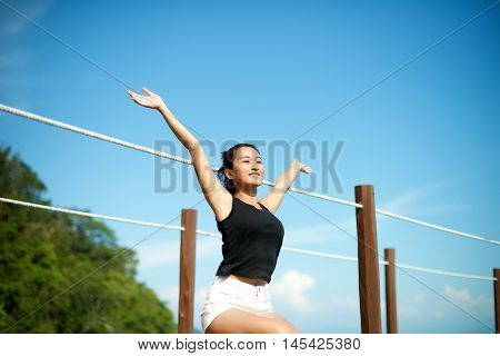 Girl Arms Open In The Nature