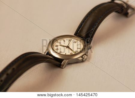 An old style wristwatch running with a battery