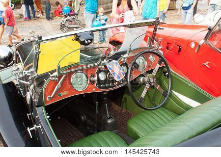 TISNOV, CZECH REPUBLIC - SEPTEMBER 3, 2013:  The traditional meeting of fans of vintage cars and motorbikes. An exhibition of old cars in the town square of Tisnov. Detail of veteran cars