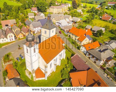 Aerial view to center of medieval village Velhartice with gothic church. Beautiful landmark in National Park Sumava. Czech Republic, Central Europe.