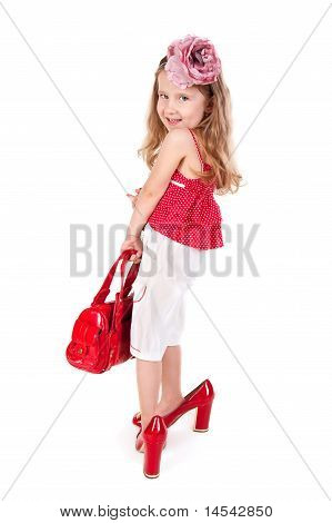 Funny Little Girl Trying On Her Mother's Shoes