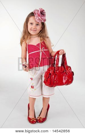Funny Little Girl In Her Mother's Shoes