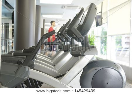 Interior of a modern fitness hall with close-up ellipticals