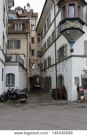 LUCERNE SWITZERLAND - MAY 04 2016: A small street between houses in the old town shows the diversity of the city visited by many tourists that offers the multitude of tourist attractions