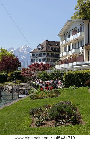 WEGGIS SWITZERLAND - MAY 05 2016: Hotels by the Lake Lucerne in famous tourist destination that is frequently visited because of the many attractions in the town itself and its surroundings