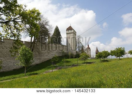 LUCERNE SWITZERLAND - MAY 04 2016: Towers of Lucerne's ancient city walls. These historic fortifications are called Musegg and are mostly very well preserved