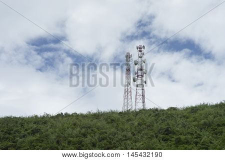 Stanchion Of Telecommunication Mast Tv Antennas Wireless Technology On A Hilltop Of Green Mountain,