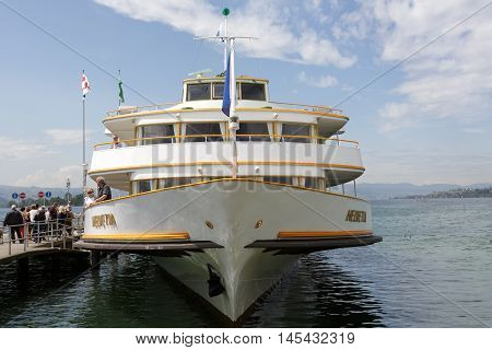 RAPPERSWIL SWITZERLAND - MAY 10 2016: Motor ship was buit in 1964 is moored at the ferry terminal in Rapperswil. It was named Helvetia that is the female national personification of Switzerland