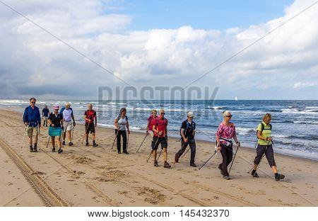 Kijkduin beach the Netherlands - September 03 2016: senior nordic walkers on the beach