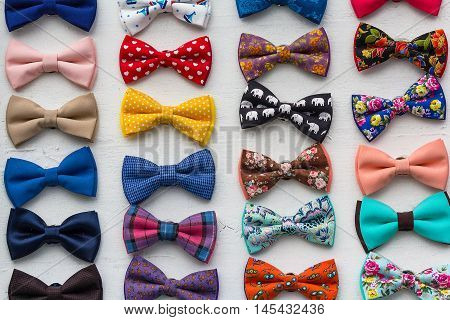Сolorful bow ties are located in the window. Styles