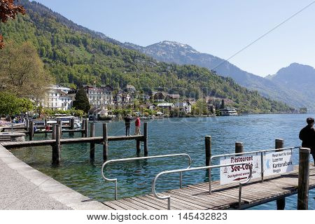 WEGGIS SWITZERLAND - MAY 05 2016: Wooden piers on the waterfront emphasize the tourist nature of the town on the shores of Lake Lucerne that provides many tourist attractions