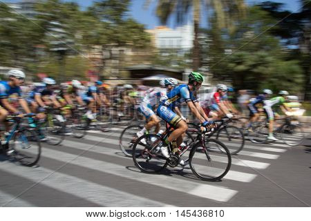 VALENCIA, SPAIN - SEPTEMBER 1, 2016: Start of the Volta de Valencia, which is a four day bicycle race covering 318 miles throughout the Valencia Province. Intentional motion blur in camera.