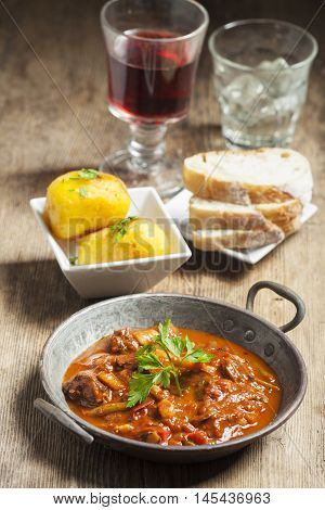 hungarian goulash in a pot with red wine
