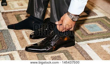 Shiny Black Men's Shoes For The Bride, Lying On The Floor