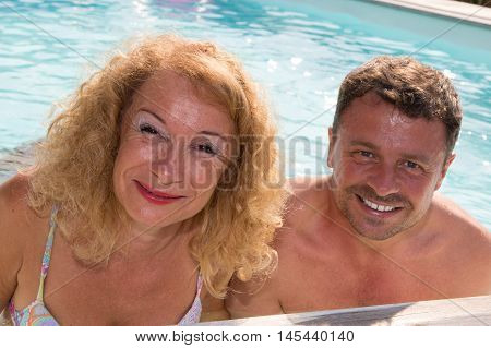 a Mature couple relaxing in Swimming Pool