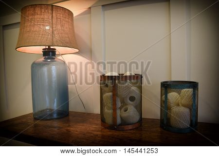 Abstract of jug lamp and containers of string