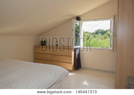 Bright Bedroom In Attic With Big Bed