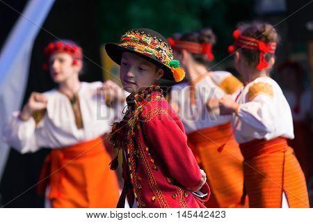 TIMISOARA; ROMANIA - JULY 9; 2016: Ukrainian children dancers in traditional costume; perform folk dance during