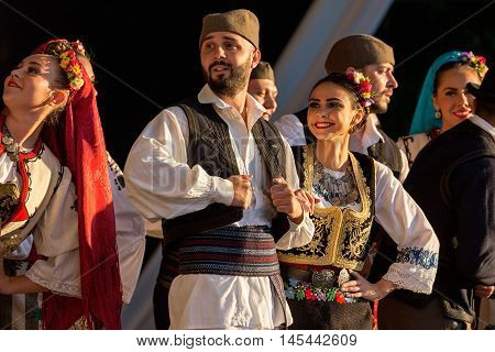 TIMISOARA ROMANIA - JULY 7 2016: Young Serbian dancers in traditional costume perform folk dance during