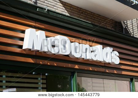 Amsterdam, The Netherlands - August 23, 2016: McDonald's sign, McDonald's is the world's largest chain of hamburger fast food restaurants, serving around 68 million customers daily in 119 countries